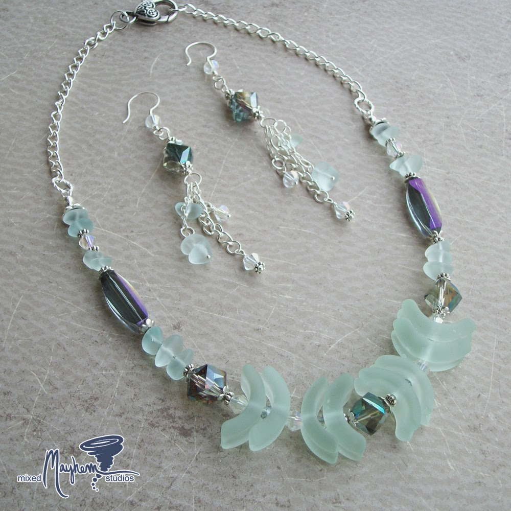 http://mixedmayhemstudios.bigcartel.com/product/cultured-sea-glass-and-tiara-crystal-necklace